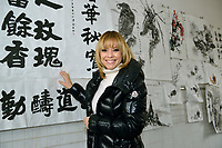 "Swiss singer and TV presenter Francine Jordi sees painting exhibition by students while visiting ""SOS Kinderdorf"" in Tianjin, China.  22-Mar-2016"