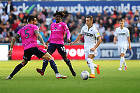 Geoff Cameron of Queens Park Rangers vies for possession with Bersant Celina of Swansea City during the Sky Bet Championship match between Swansea City and Queens Park Rangers at the Liberty Stadium in Swansea, Wales. Saturday 29 September 2018