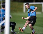 Fraser Aird slots the ball past Steve Simonsen