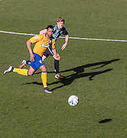 Ryan Sellers of Wycombe Wanderers & Matt Green of Mansfield Town chase down the ball during the Sky Bet League 2 match between Wycombe Wanderers and Mansfield Town at Adams Park, High Wycombe, England on 25 March 2016. Photo by Andy Rowland.