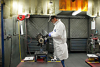 Joe Villanenl applies a radius on a GE90-115B fan blade