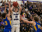 Spanish Springs guard Mason Whittaker (15) shoots over        Reed guard Trey Stevens (3) and Jarek Cook (15) during the first half of the class 4A Northern Regional Boys Basketball Championship game at Spanish Springs High School in Sparks