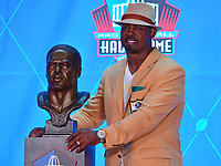 Canton, OH - August 4, 2018: Former NFL safety  Brian Dawkins poses with his bust during the Pro Football Hall of Fame enshrinement ceremony at the Tom Benson Hall of Fame Stadium, August 4, 2018, in Canton, Ohio. Dawkins played with the Philadelphia Eagles from 1996-2008 and the Denver Broncos from2009-2011. (Photo by Don Baxter/Media Images International)