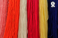 Colorful dyed wool hanging in shop,Tunisia (Licence this image exclusively with Getty: http://www.gettyimages.com/detail/106882016 )