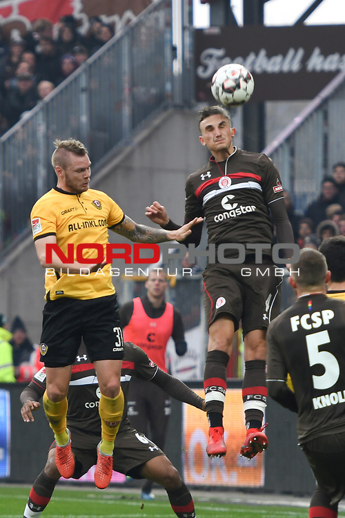 01.12.2018,  GER; 2. FBL, FC St. Pauli vs SG Dynamo Dresden ,DFL REGULATIONS PROHIBIT ANY USE OF PHOTOGRAPHS AS IMAGE SEQUENCES AND/OR QUASI-VIDEO, im Bild Dario Dumic (Dresden #03) versucht sich gegen Philipp Ziereis (Pauli #04) durchzusetzen Foto © nordphoto / Witke *** Local Caption ***