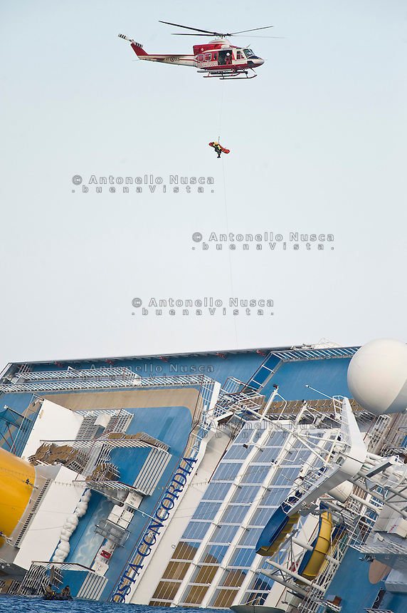 Island of Giglio, Italy, January 15, 2012.  A helicopter evacuates Marrico Giampietroni, the Costa Concordia's cabin service director after he was rescued from the Costa Concordia.