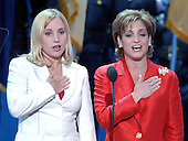 New York, NY - September 2, 2004 --  Olympians Kerri Strug, left, and Mary Lou Retton, right, lead the Pledge of Allegiance at the 2004 Republican Convention in Madison Square Garden in New York, New York on Thursday, September 2, 2004..Credit: Ron Sachs / CNP.(RESTRICTION: No New York Metro or other Newspapers within a 75 mile radius of New York City)