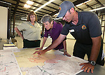 Incident Commander Chris Wilcox briefs Secretary of the Interior Sally Jewell, center, on the Washington fire from a command post in Gardnerville, Nev. area on Wednesday, June 24, 2015. The lighning-caused fire near Markleeville, Ca. has grown to nearly 17,000 acres since Friday. Irene Davidson with the U.S. Forest Service is at left.  <br /> Photo by Cathleen Allison