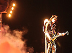 Lead Kiss guitarist Tommy Thayer plays 20 feet above the crowd during the opening night concert at Frontier Park Friday night. Before replacing original band member Ace Frehley in 1991, Thayer was in a 80's heavy metal band Black and Blue..Michael Smith/staff