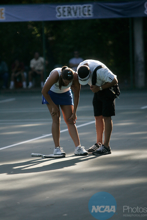 16 MAY 2009:  Lynn Univeristy's Eleonora Iannozzi is examined by a trainer during the Division II Women's Tennis Championship held at Sanlando Park in Altamonte Springs, FL.  Armstrong Atlantic State University beat Lynn University 5-2 to claim the national title.  Chris Livingston/NCAA Photos