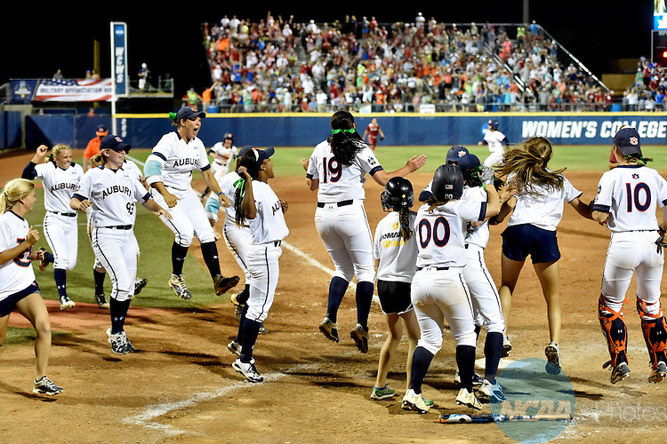 07 JUNE 2016:  Auburn celebrates after Auburn infielder Emily Carosone (5) hit a home run during the Division I Women's Softball Championship is held at ASA Hall of Fame Stadium in Oklahoma City, OK. Auburn defeated Oklahoma 11-7. Shane Bevel/NCAA Photos
