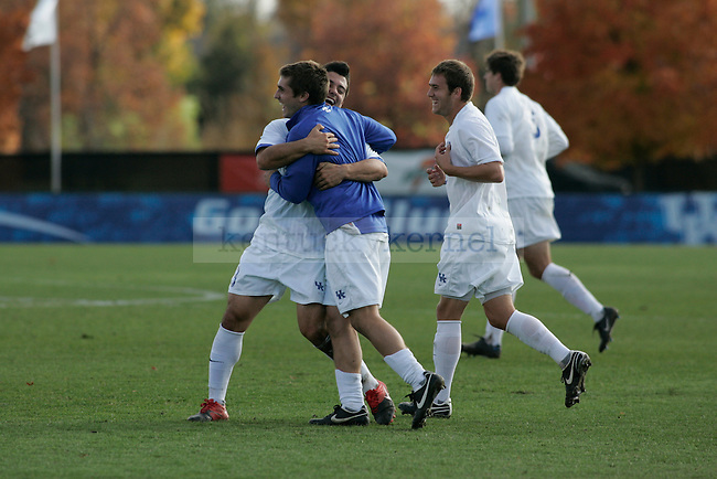 The UK men's soccer team celebrates after their win over SMU at Softball and Soccer Complex on Wednesday, Nov. 4, 2009. Photo by Allie Garza | Staff