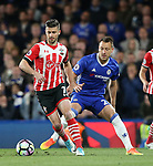 Chelsea's John Terry tussles with Southampton's Shane Long during the Premier League match at Stamford Bridge Stadium, London. Picture date: April 25th, 2017. Pic credit should read: David Klein/Sportimage