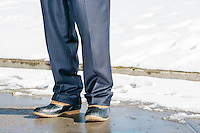 Wearing new boots, former Virginia governor and Republican presidential candidate Jim Gilmore stands outside the Radisson Hotel in downtown Manchester, New Hampshire, on the day of primary voting, Feb. 9, 2016. Most television and radio organizations set up at the Radisson to broadcast their campaign coverage during the final days of the primary. Gilmore finished in last place among major Republican candidates still in the race with a total of 150 votes.