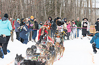 Lance Mackey and team run past spectators on the bike/ski trail near University Lake with an Iditarider in the basket and a handler during the Anchorage, Alaska ceremonial start on Saturday, March 7 during the 2020 Iditarod race. Photo © 2020 by Ed Bennett/Bennett Images LLC