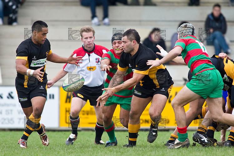 Joseph Faliu is under pressure from Heinie Fourie and Matty Hamilton as he passes to Joe Heta. Counties Manukau Premier Club Rugby game between Waiuku and Bombay, played at Waiuku on Saturday July 5th 2010. Waiuku won 59 - 14 after trailing 12 - 14 at halftme.