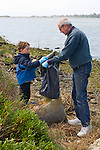 Oakland CA Grandfather and grandson; fivs, working to clean up Alameda County Shoreline on Earth Day  MR