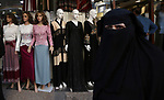 Palestinians shop at a market ahead of Eid al-Fitr holiday in the West Bank city of Nablus, on June 13, 2018. Eid al-Fitr marks the end of Muslim's holy fasting month of Ramadan when faithfuls abstain from eating, drinking, smoking and sexual activities from dawn to dusk. Photo by Ayman Ameen
