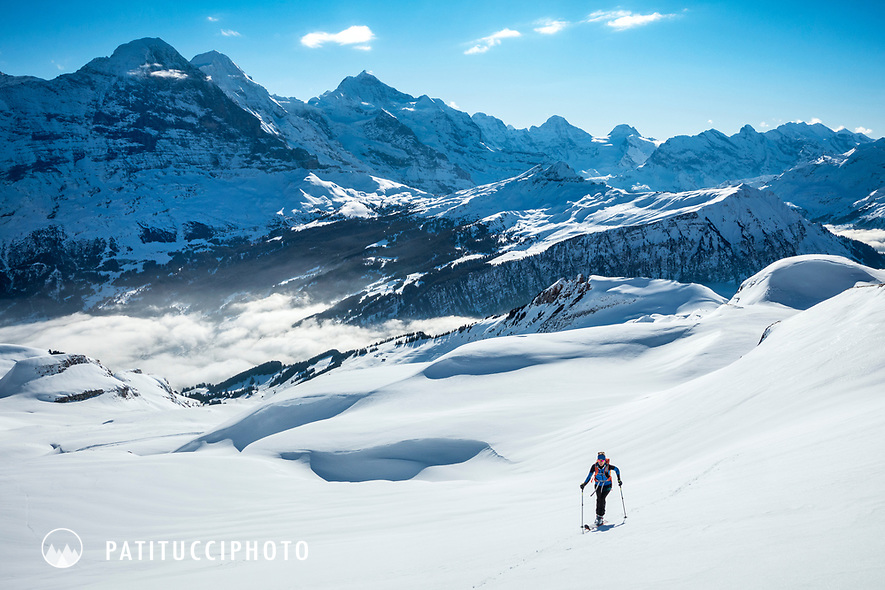 Ski touring on the Faulhorn with views to the Eiger, Mönch and Jungfrau, in the Berner Oberland, high above Grindelwald, Switzerland