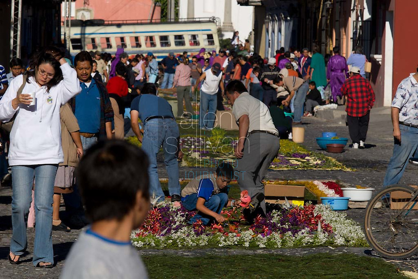 People make alfombras, or carpets, of colored sawdust and flowers during the Procesión de Jesús Nazareno de La Caída from Iglesia San Bartolomé Becerra in Antigua, Guatemala. Each weekend during Lent features a procession by a different church, culminating in Semana Santa, or Holy Week, one of the largest Easter commemorations in Latin America.