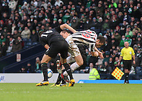 John  McGinn beaten by the combined effort of Joe Ledley and Scott Brown in the St Mirren v Celtic Scottish Communities League Cup Semi Final match played at Hampden Park, Glasgow on 27.1.13.