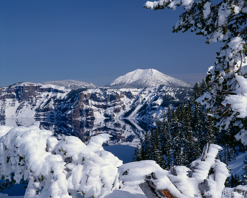 67ORCL_02 - USA, Oregon, Crater Lake National Park, Winter snow accumulates at Crater Lake and on distant Mount Scott.