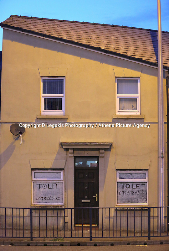 Pictured: The end of terrace house (L) resembling the face of Adolf Hitler and has become an internet sensation, on Fabian Way, Swansea south Wales. STOCK PICTURE<br /> Re: A house that looks like Hitler is up for rent after it became a tourist attraction.<br /> Landlord Clive Davies, 70, refuses to cash in on the house's notoriety and the new tenant can move in for just £85-a-week.<br /> The house, in Swansea, South Wales, became an internet sensation after locals noticed it looked like the German dictator.<br /> People arrived to have their photographs taken outside the property which has belonged to Mr Davies's family for generations.<br /> It was easy enough to find - you drive into Swansea and take the third reich.       <br /> The house is divided into two flats with the groundfloor available for rent.