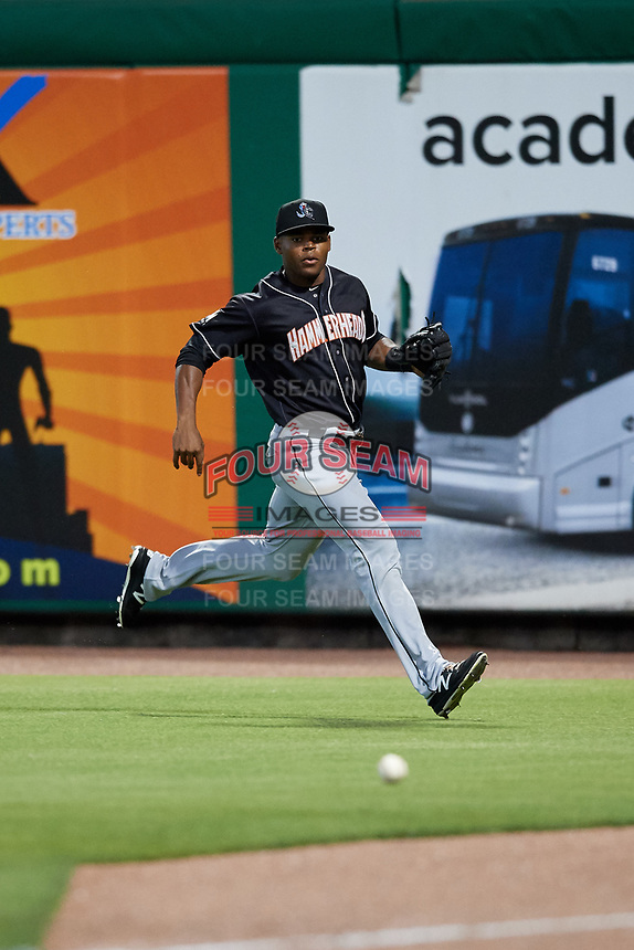 Jupiter Hammerheads right fielder Stone Garrett (11) fields a ball during a game against the Clearwater Threshers on April 12, 2018 at Spectrum Field in Clearwater, Florida.  Jupiter defeated Clearwater 8-4.  (Mike Janes/Four Seam Images)
