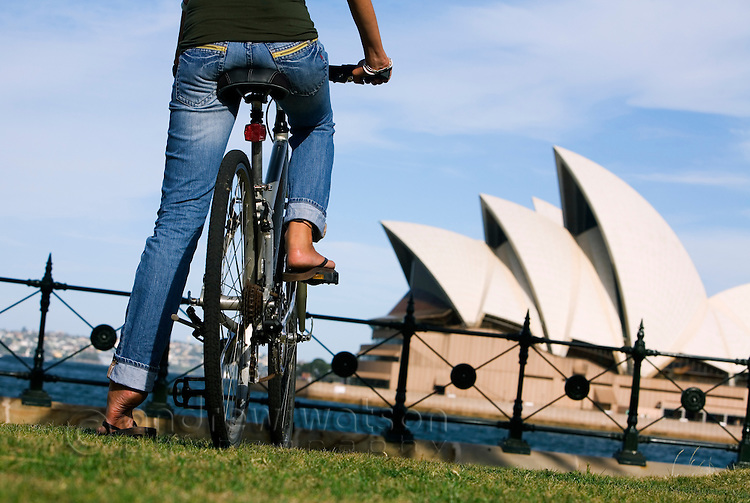 A young woman looks out to the Opera House from Dawes Point.  Sydney, New South Wales, AUSTRALIA.