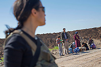 KURDISTAN, NORTHERN IRAQ, Dokuk.<br /> Qalubna Ma'Kum Feature:<br /> Qalubna Ma'kum (meaning &quot;Our hearts are With You&quot;) are a group of foreign volunteer fighters who have joined up with the Peshmerga in Kurdistan to help with the battle against Daesh, also known as ISIS. <br /> <br /> Pictured: Co-founder of Qalubna Ma'kum Kat Argo watches on as an internally displaced family they have just found waits for questioning.