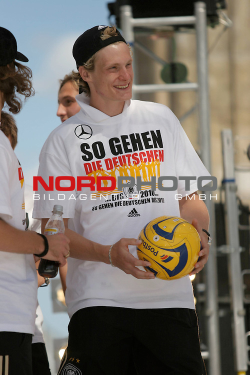 UEFA Euro 2008 Fan Meile Berlin - Empfang der Deutschen Mannschaft am Brandenburger Tor <br /> <br /> Marcell Jansen ( Germany  / Verteidiger / Defender / Bayern Muenchen #2) <br /> <br /> Foto &copy; nph (  nordphoto  )<br /> <br /> <br /> <br />  *** Local Caption ***