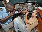 Stephen Quigg (right), a United Methodist missionary, working in the hangar of Wings of Caring Aviation in Kananga, Congo. The program is sponsored by the United Methodist Church. The Kananga-based pilot on the left is Jacques Umembudi Akasa.