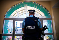 Police constable Alan Reece stands guard. NZ marks one week since Christchurch terror attacks. Wellington Islamic Centre in Wellington, New Zealand on Friday, 22 March 2019. Photo: Dave Lintott / lintottphoto.co.nz
