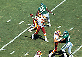 Washington Redskins quarterback Doug Williams (17) looks to pass the ball during the game against the Philadelphia Eagles at RFK Stadium in Washington, DC  on September 18, 1988.  The Redskins won the game 17 - 10. <br /> Credit: Arnie Sachs / CNP