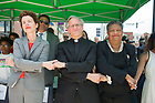 June 21, 2017; University of Notre Dame president Rev. John I. Jenkins, C.S.C., joins hands with community leaders as they sing We Shall Overcome at the unveiling of the new sculpture of the Rev. Theodore M. Hesburgh and the Rev. Martin Luther King in downtown South Bend.  (Photo by Barbara Johnston/University of Notre Dame)