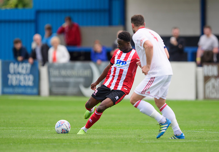 Lincoln City's Jordan Adebayo-Smith vies for possession with Lincoln United's Matt Wilson<br /> <br /> Photographer Chris Vaughan/CameraSport<br /> <br /> Football Pre-Season Friendly (Community Festival of Lincolnshire) - Lincoln City v Lincoln United - Saturday 6th July 2019 - The Martin & Co Arena - Gainsborough<br /> <br /> World Copyright © 2018 CameraSport. All rights reserved. 43 Linden Ave. Countesthorpe. Leicester. England. LE8 5PG - Tel: +44 (0) 116 277 4147 - admin@camerasport.com - www.camerasport.com