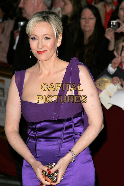 JK ROWLING.The Galaxy British Book Awards held at the Grosvenor Hotel, Park Lane, London, England. .April 9th 2008 .half length dress purple cleavage gold clutch bag J.K. Joanne red lipstick .CAP/AH.©Adam Houghton/Capital Pictures.