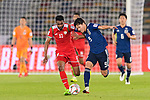 Ahmed Al Mahaijri of Oman (L) fights for the ball with Minamino Takumi of Japan (R) during the AFC Asian Cup UAE 2019 Group F match between Oman (OMA) and Japan (JPN) at Zayed Sports City Stadium on 13 January 2019 in Abu Dhabi, United Arab Emirates. Photo by Marcio Rodrigo Machado / Power Sport Images