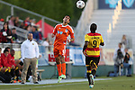 20 April 2013: Carolina's Austin da Luz (6) heads the ball over Fort Lauderdale's Jemal Johnson (ENG). The Carolina RailHawks played the Fort Lauderdale Strikers at WakeMed Stadium in Cary, North Carolina in a North American Soccer League Spring 2013 Season regular season game.