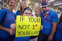 HORSHAM, PA - AUGUST 22: John Huber, 11 holds a sign as his family gathers around  Mary Bodenstine (2 from right), 76, of Folcroft, Pennsylvania after she won heat 3 to move not the finals at the Granny Grampy Grand Prix at Speed Raceway August 22, 2014 in Horsham, Pennsylvania. Grandparents competed in electric go cart races to win a trip for four to Florida for the grandchild that entered them into the contest, which was sponsored by radio station WMMR. (Photo by William Thomas Cain/Cain Images)