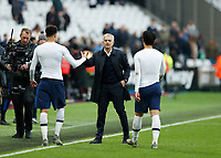 23rd November 2019; London Stadium, London, England; English Premier League Football, West Ham United versus Tottenham Hotspur; Tottenham Hotspur Manager Jose Mourinho congratulates Dele Alli and Son Heung-Min of Tottenham Hotspur after full time - Strictly Editorial Use Only. No use with unauthorized audio, video, data, fixture lists, club/league logos or 'live' services. Online in-match use limited to 120 images, no video emulation. No use in betting, games or single club/league/player publications