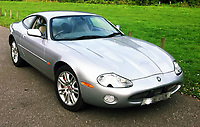 COPY BY TOM BEDFORD<br /> Pictured: The silver Jaguar XKR owned by Tim Lundy<br /> Re: A shamed police sergeant died in a high-speed car crash after posting naked pictures of a woman on social media.<br /> Sgt Tim Lundy, 44, was also accused of putting her collection of sex toys in a window for neighbours to see.<br /> The Metropolitan Police officer's career was in ruins after he was charged with revenge porn offences and harassment.<br /> An inquest heard Sgt Lundy lost control of his silver Jaguar XKR sports car and crashed into a tree on a country road.<br /> He was cut from the wreckage but died at the scene near the village of Norton, Worcester, where he lived.<br /> The crash happened two weeks after Sgt Lundy admitted harassment and disclosing private sexual photographs with intent to cause distress.