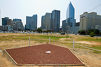 The Charlotte skyline sits in the background of a home plate on the site of a proposed new ballpark for the Charlotte Knights, Triple-A affiliate of the Chicago White Sox.  The Knights currently play at Knights Stadium which is actually located in Fort Mill, South Carolina.  (Brian Westerholt / Four Seam Images)