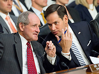 "United States Senator Jim Rich (Republican of Idaho), left, and US Senator Marco Rubio (Republican of Florida) have a discussion as US Attorney General Jeff Sessions testifies before the US Senate Select Committee on Intelligence to  ""examine certain intelligence matters relating to the 2016 United States election"" on Capitol Hill in Washington, DC on Tuesday, June 13, 2017.  In his prepared statement Attorney General Sessions said it was an ""appalling and detestable lie"" to accuse him of colluding with the Russians. Photo Credit: Ron Sachs/CNP/AdMedia"
