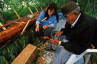 Native Alaskan Athabascan artisans demonstrate a traditional birch bark canoe sewing technique. Alaska Native Heritage Cultural Center, Anchorage, Alaska.