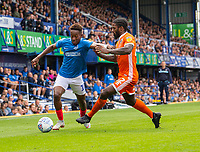 Shrewsbury Town's Anthony Grant (right) battles with Portsmouth's Jamal Lowe (left) <br /> <br /> Photographer David Horton/CameraSport<br /> <br /> The EFL Sky Bet League One - Portsmouth v Shrewsbury Town - Saturday September 8th 2018 - Fratton Park - Portsmouth<br /> <br /> World Copyright &copy; 2018 CameraSport. All rights reserved. 43 Linden Ave. Countesthorpe. Leicester. England. LE8 5PG - Tel: +44 (0) 116 277 4147 - admin@camerasport.com - www.camerasport.com