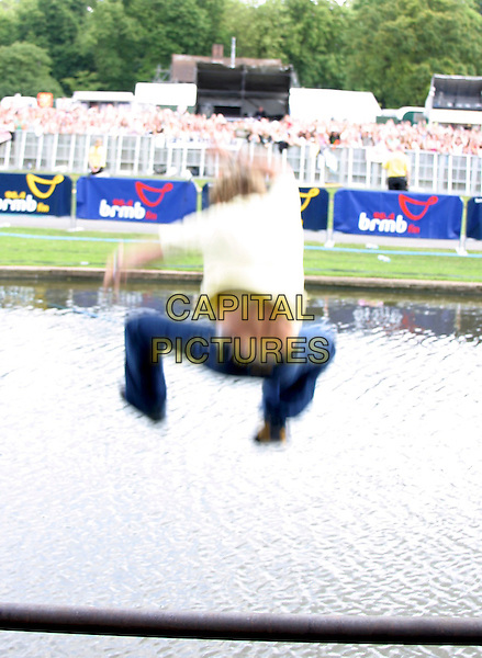 FREEFALLER - OLLIE .Performs Live in Concert at .96.4 BRMB's Party In The Park, .Cannon HIll Park, Birmingham, .July 3rd 2005..full length funny jumping in river water over fence.Ref: JEZ.www.capitalpictures.com.sales@capitalpictures.com.©Jez Self/Capital Pictures