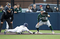 Michigan State Spartans first baseman Zach McGuire (55) waits for a pick off throw as Michigan Wolverines baserunner Jonathan Engelmann (2) dives back to the bag on May 19, 2017 at Ray Fisher Stadium in Ann Arbor, Michigan. Michigan defeated Michigan State 11-6. (Andrew Woolley/Four Seam Images)