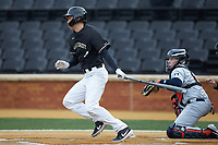 DJ Poteet (4) of the Wake Forest Demon Deacons follows through on his swing against the Illinois Fighting Illini at David F. Couch Ballpark on February 16, 2019 in  Winston-Salem, North Carolina.  The Fighting Illini defeated the Demon Deacons 5-2. (Brian Westerholt/Four Seam Images)