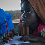 A girl in school in the Kaya Refugee Camp in Maban County, South Sudan. The camp shelters thousands of refugees, including this girl, from the Blue Nile region of Sudan, and Jesuit Refugee Service, with support from Misean Cara, provides educational and psycho-social services to both refugees and the host community.